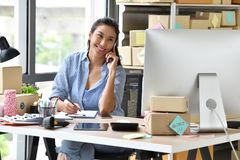 Young Asian Woman Entrepreneur/ Business Owner Working With Computer At Home Stock Images