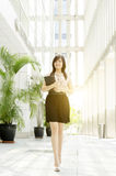 Young Asian woman executive walking Stock Photo