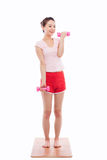 Young Asian woman  exercise with dubbbell Royalty Free Stock Photography