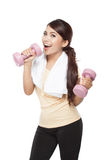 Young asian woman exercising, holding barbell, isolated Royalty Free Stock Photos