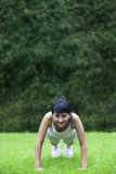 Young Asian woman exercising outdoor Royalty Free Stock Images