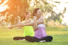 Young asian woman exercising in park. Stock Image