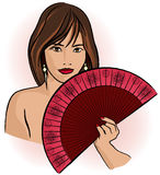Young asian woman with a fan Stock Image