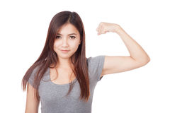 Young Asian woman flexing her biceps Royalty Free Stock Image