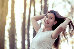 Young asian woman flicking her hair and enjoying the nature Stock Photos