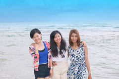 Young asian woman friend relaxing happiness vacation on sea beac Stock Photography