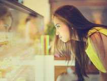 Young Asian woman in front of sweet candy food store Royalty Free Stock Image