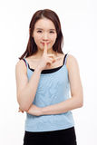 Young Asian woman gesture dont' make sound. Royalty Free Stock Image