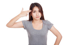 Young Asian woman gesturing  gun to head Stock Photography
