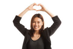 Young Asian woman gesturing  heart hand sign. Royalty Free Stock Photography