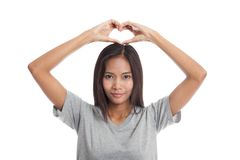 Young Asian woman gesturing  heart hand sign. Stock Image