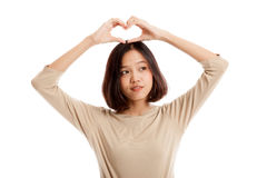 Young Asian woman gesturing  heart hand sign Stock Photos