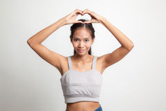 Young Asian woman gesturing  heart hand sign. Stock Photography