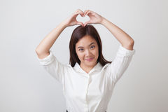 Young Asian woman gesturing  heart hand sign. Royalty Free Stock Photos