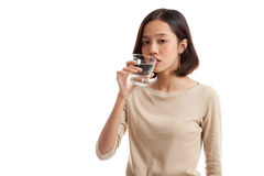 Young Asian woman with a glass of drinking water Royalty Free Stock Photo