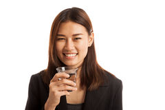 Young Asian woman with a glass of drinking water. Stock Photography
