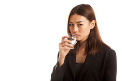 Young Asian woman with a glass of drinking water. Stock Photos