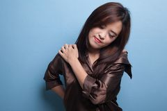 Young Asian woman got back pain. Royalty Free Stock Photography