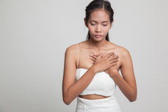 Young Asian woman got chest pain. Royalty Free Stock Images