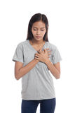Young Asian woman got chest pain. Stock Images