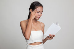 Young Asian woman got headache read a book. Stock Photography