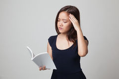 Young Asian woman got headache read a book. Stock Images