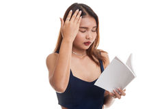 Young Asian woman got headache read a book. Royalty Free Stock Photography
