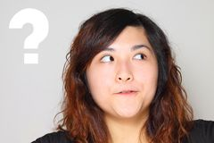 Young asian woman got a question and thinking Stock Photo