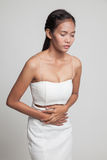 Young Asian woman got stomachache. Stock Photo
