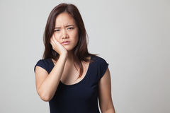 Young Asian woman got toothache. Royalty Free Stock Photos