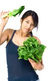 Young Asian woman with green vegetables Royalty Free Stock Images