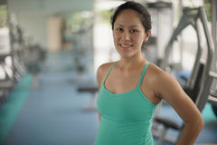 Young asian woman in gym keeping fit Royalty Free Stock Image