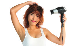 Young asian woman with hair-dryer Royalty Free Stock Photo