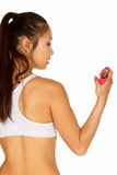 Young Asian Woman with Hand Grip. Young Asian in Sports Bra with Hand Grip Stock Images