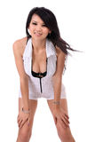 Young Asian woman hands on knees cleavage Royalty Free Stock Photos