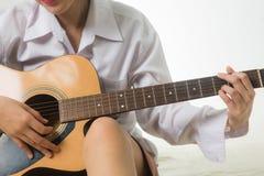 Asian woman hands touching guitar chords. Young Asian woman hands touching guitar chords royalty free stock photos