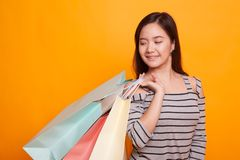 Young Asian woman happy with shopping bag. Stock Photos