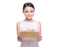Young asian woman happy smile hold gift box in hands, isolated o Stock Image