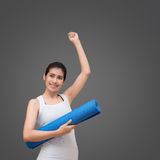 Young asian woman with happy smile holding her yoga mat Stock Photos