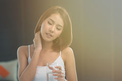 Young Asian woman has a pain in the neck. stock images