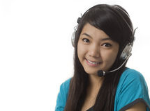 Young Asian woman with headset Stock Image