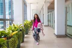 Young woman with her luggage at an international airport. stock photos