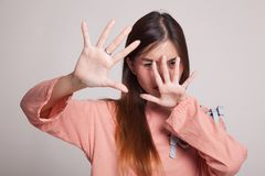 Young Asian woman hide her  face. Young Asian woman hide her  face on gray background Royalty Free Stock Photography
