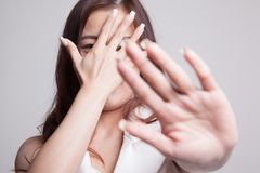 Young Asian woman hide her  face. Young Asian woman hide her  face on gray background Stock Photography