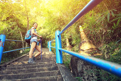 Young asian woman hiker climbing on stone stairs Stock Photography