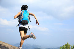 Young asian woman hiker running on mountain peak Royalty Free Stock Photos