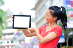 Young asian woman hold blank digital tablet Royalty Free Stock Photos