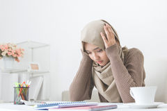 Young asian woman hold her head thinking about something Stock Image