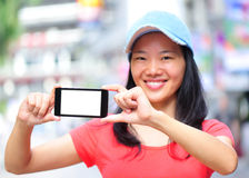 Young asian woman hold smart phone Stock Photo