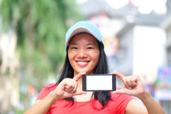 Young asian woman hold smart phone Stock Images